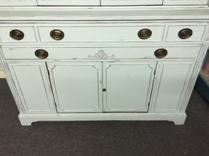 A close up of the finished cabinet with the decorative piece added.