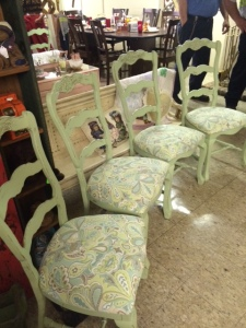 green chairs in shop