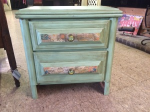 nightstand with 2 drawers - has maps decoupaged on the drawers and map drawer knobs, has antiquing glaze on it