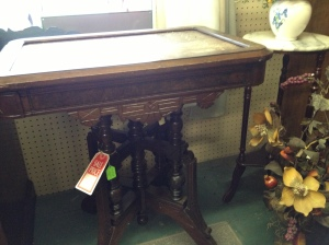 Chocolate Marble Table has intricate carvings $470