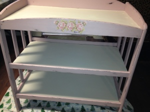 After: Painted pink and distressed baby changing table