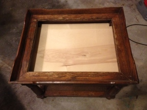 A piece of wood was inserted by my husband to make it into a shadow box table
