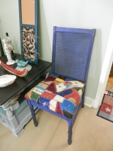 After pic of cane back chair - painted two tone w/ blue and black and antiqued w/ black glaze. Has beautiful quilted look fabric.