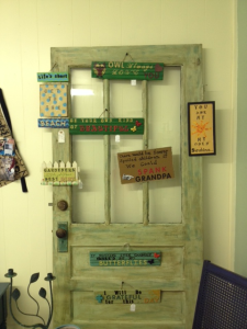 I'm using the finished door in my shop to hang some of my handmade signs.